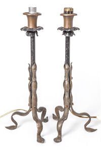 "In iron, bronze and copper with three cast bronze scrolled leaf form legs with hammered finish, black iron column with iron flower form drip pans and copper flower bulb form socket.   17"" high."