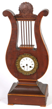 INLAID MAHOGANY LYRE FORM CLOCK