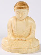 ORIENTAL CARVED IVORY SEATED BUDDHA
