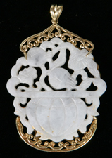 CHINESE WHITE JADE PENDANT ON 18K GOLD MOUNT