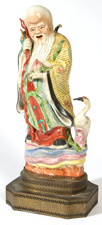 EARLY CHINESE PORCELAIN FIGURE OF IMMORTAL