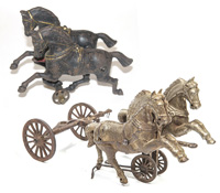 TWO CAST IRON DOUBLE HORSE TEAMS