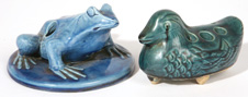 TWO ARTS & CRAFTS POTTERY FIGURAL FLOWER FROGS