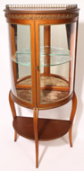 FRENCH STYLE CURVED GLASS CURIO CABINET