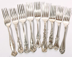 9 PIECES OF STERLING SILVER FORKS