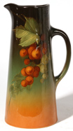 WELLER POTTERY LOUWELSA TANKARD W/FRUIT DEC.